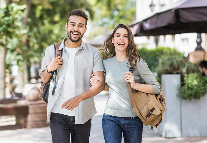 Student couple walking on campus UBC Chiropractic services